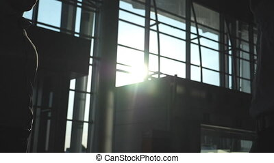 Business handshake indoor at office with sun flare at...