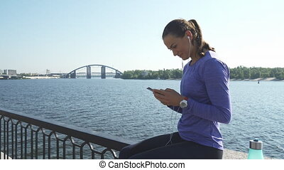 Woman sits and talk via phone - Young woman sits on the...