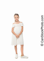 cute preteen girl in casual dress looking at camera on white...