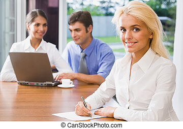 Pretty female office worker - Pretty smiling woman on a...
