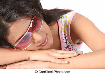 Teenage girl with cooling glass