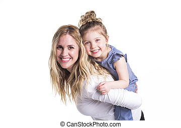 young mother hugging her little daughter isolated on white -...