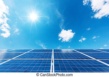 Solar power station against the blue sky. Alternative energy...