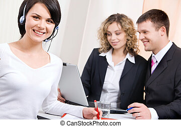 Woman with headset - Being part of successful business team