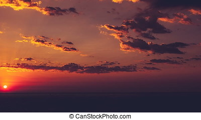Timelapse of sunrise over the sea with clouds on sky....