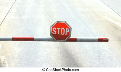 sign stop - opening a barrier with the sign of stop