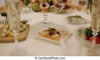 Food in restaurant. Decorated table.