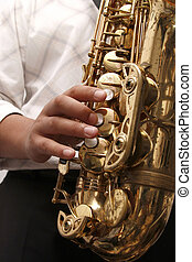 jazz - Jazz saxophone player playing a solo at a concert
