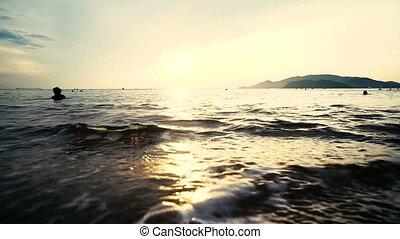Beautiful sunrise over the sea waves.