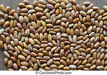 Pinto beans background. - Orange dried pinto beans texture.