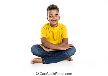 Adorable african boy on studio white background - An...
