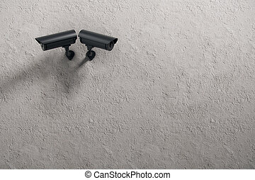 Robbery concept - Two black CCTV cameras on concrete wall...