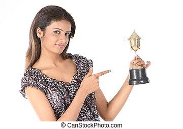 Teenage girl  holding  trophy
