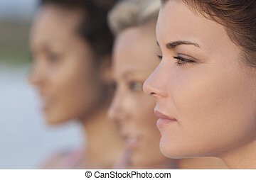Three Beautiful Young Women In Profile