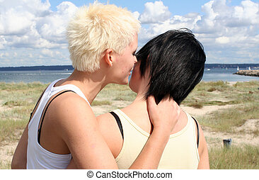 Two young women - two young women holding eachother at the...