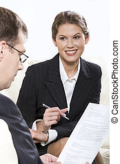 Advisor - Smiling businesswoman with pan in her hand sitting...