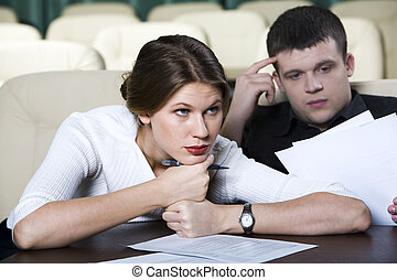 Boring lecture - Pretty tired woman sitting at the table in...