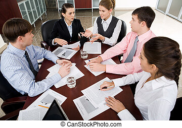 Business meeting - Photo of businesspeople gathered around...