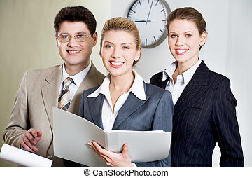 Three people - Portrait of three smiling businesspeople...
