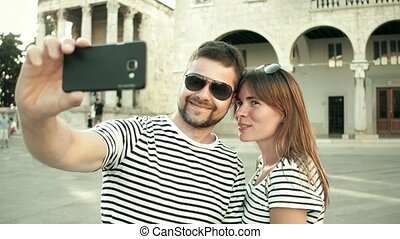 Young happy couple making selfie on vacation - Young happy...
