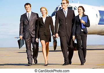 Walking people - Group of successful people walking on the...