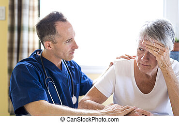 Senior woman with the caregiver at home
