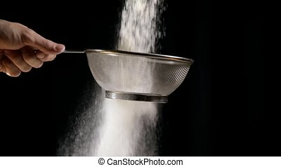 White flour on black background slow motion from 120 fps -...