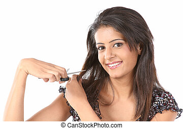woman cutting her hair - Indian woman cutting her hair with...