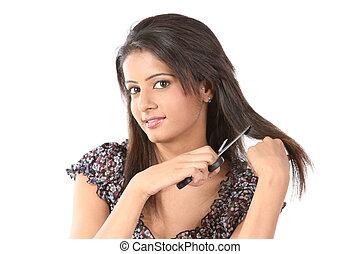 teenage girl cutting her hair - Indian teenage girl cutting...