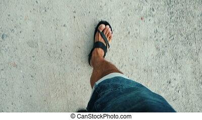 Gait in sandals.The man walking in the beach style. - Gait...