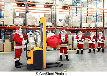 santa clauses workers - group of santa clauses standing in...