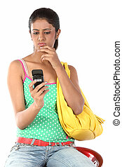 Teenage girl sending sms - Young student girlwith notebook...