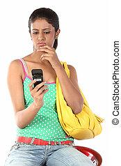 Teenage girl sending sms