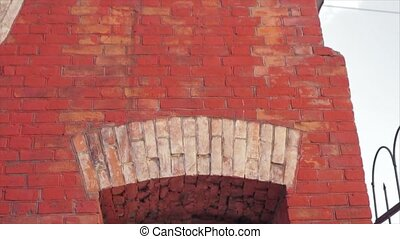 Bride And Groom Kiss Under Arch of Red Brick Slow Motion