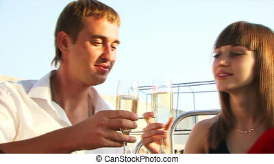 Romantic dinner on a yacht - Beautiful couple sitting on the...