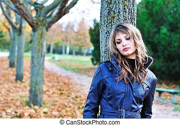 grief - sad teen girl in the autumn park