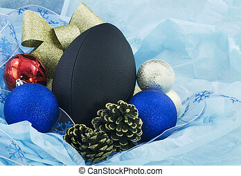 Christmas Football Cheer - Football nestled with blue tissue...