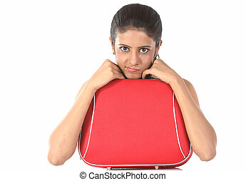 Teenage girl with suitcase