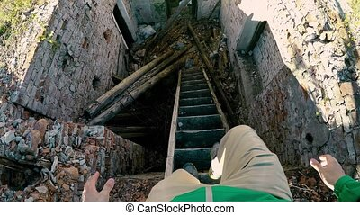 Descending the old staircase