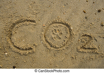 Carbon footprint - Co2 text with paw print on beach