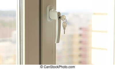 Child's hand on secure window handle