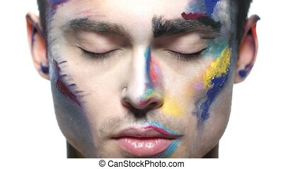 Male face, makeup art. Handsome caucasian man close up. The...
