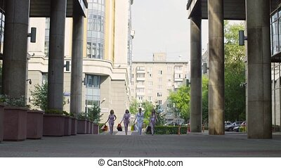 Four attractive business women walking in the city