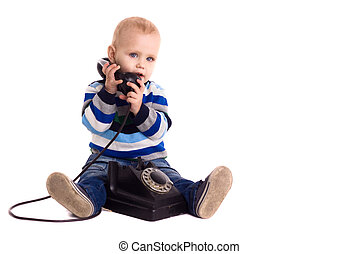 The baby boy speaks by vintage phone