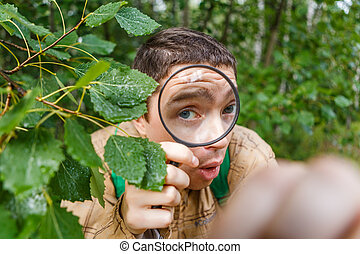 Image of ecologist man with magnifying glass in summer...