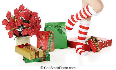 Happy Feet - Feet in long, striped socks daning among...