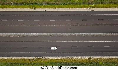 Aerial view of a truck and other traffic driving along a...