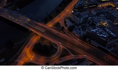 Traffic at night on the highway in Krakow, a bridge across...