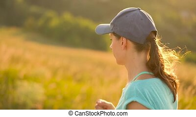 Woman runs outdoors at sunset - Young woman runs outdoors at...