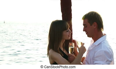 Celebratory champagne - Two lovers drink champagne aboard...